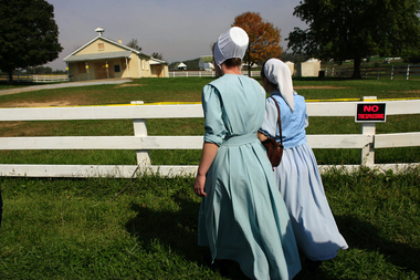 cityRUNDATE:100406--Two Amish young women from Michigan came to the West Nickel Mines Amish School, Wednesday, Oct. 4, 2006, to grieve for the killed children that were shol on Monday, in Lancaster County. The two came with a small group that had came to Pennsylvania for a wedding.(PHOTO BY GARY DWIGHT MILLER)