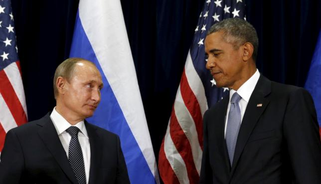 U.S. President Barack Obama and Russian President Vladimir Putin look towards one another during their meeting at the United Nations General Assembly in New York September 28, 2015. REUTERS/Kevin Lamarque